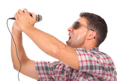 Man using headphones and singing to the microphone Stock Image
