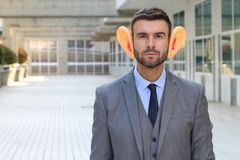 Man using hearing aid in the office stock photography