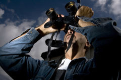 Man using his binoculars Stock Photos
