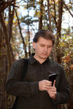 Man using his cellphone. Royalty Free Stock Photos