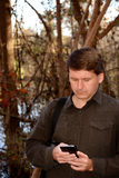 Man using his cellphone. Royalty Free Stock Photography