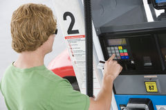 Man Using His Debit Card To Pay For Gasoline At Pump Stock Photo