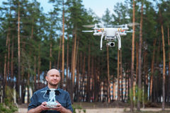 Man using his drone outdoor with forest background Stock Photography