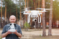 Man using his drone outdoor with forest background Royalty Free Stock Photo
