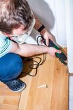 Man using his electric multi tool on laminate.  stock photos