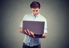 Young man using his laptop computer Royalty Free Stock Image