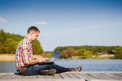 Man using his laptop computer Stock Image