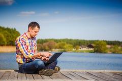Man using his laptop computer Stock Photos