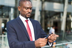 Man using his mobile phone Royalty Free Stock Image