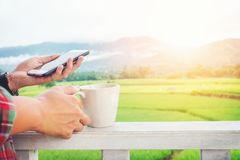 Man using his Mobile Phone outdoor in Morning Royalty Free Stock Photo