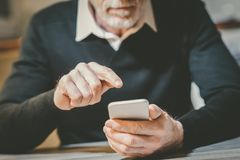 Man using his mobile phone royalty free stock images