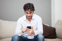 Man using his mobile phone Stock Image