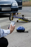 Man using his mobile phone to call for help on road Royalty Free Stock Images