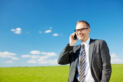Man using his mobile in a spring pasture Stock Images