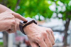 Man using his smart watch app. Close-up hands with bokeh back gr. Ound Royalty Free Stock Photography