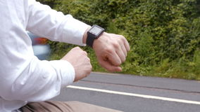 Man using his smart watch stock footage
