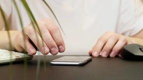 Man using his smartphone. Social network. Close up.