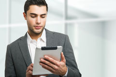 Man using his tablet computer Royalty Free Stock Photography