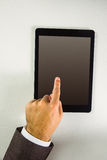 Man using his tablet pc Stock Photo
