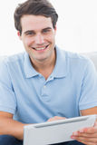 Man using his tablet Royalty Free Stock Image