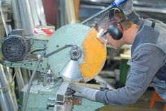 Man using industrial circular saw. Industrial stock photo