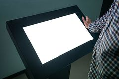Free Man Using Interactive White Empty Touchscreen Display Kiosk At Exhibition Stock Images - 160998804