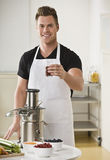 Man Using Juicer Stock Photos
