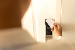 Man using keycard contactless for unlock door in hotel. Royalty Free Stock Photos