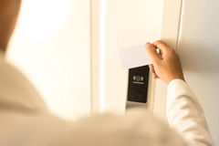 Man using keycard contactless for unlock door in hotel. Stock Images