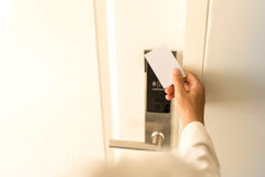 Man using keycard contactless for unlock door in hotel. Royalty Free Stock Image