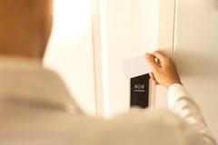Man using keycard contactless for unlock door in hotel. Stock Image