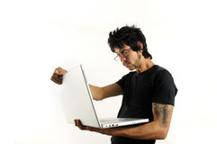 Man using laptop. Portrait of young hispanic man holding a laptop isolated on white Stock Photos