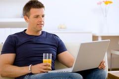 Man using laptop Stock Images