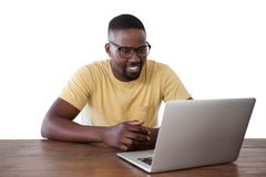 Man using laptop against white background. Smiling man using laptop against white background Royalty Free Stock Photos