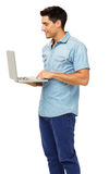 Man Using Laptop Against White Background Stock Photos