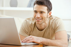 Man Using Laptop At Home Royalty Free Stock Photos