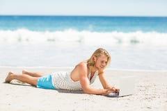 Man using laptop on beach Royalty Free Stock Photography