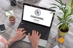 Coaching concept on a laptop. Man using a laptop with coaching concept on the screen Royalty Free Stock Photography