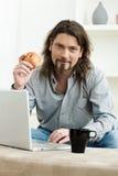 Man using laptop computer Stock Images