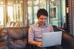 Man using laptop computer in cafe stock photo