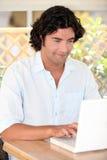 Man using a laptop computer Royalty Free Stock Photo