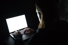 Man using laptop computer at home indoors at night. Stock Photos
