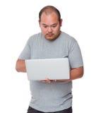 Man using laptop computer Stock Photo