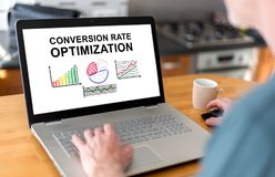 Conversion rate optimization concept on a laptop. Man using a laptop with conversion rate optimization concept on the screen stock image