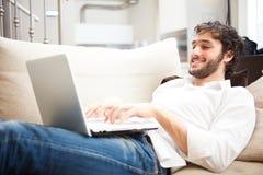 Man using a laptop stock image