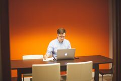 Man using laptop at desk Royalty Free Stock Photo