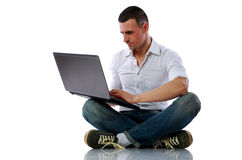Man using laptop on the floor Stock Images