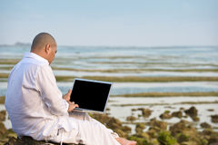 Man using laptop while having his holiday Stock Photography