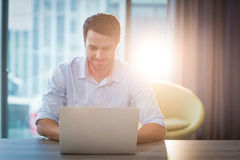 Man using laptop at his desk. In the office Royalty Free Stock Image