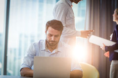 Man using laptop at his desk. In the office Royalty Free Stock Photography